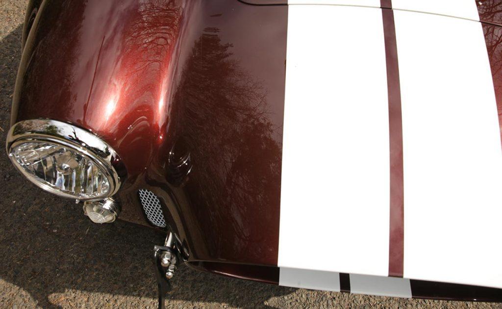 hi-angle shot of nose of Chesnut Metallic Superformance 427SC Shelby classic Cobra for sale, SPO1886