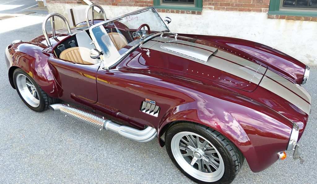 3/4-frontal (passenger side) photo of Prism Red Backdraft Racing 427SC Shelby classic Cobra for sale, BDR625
