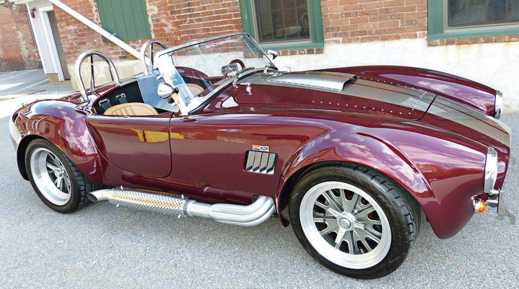 broadside shot (passenger side) of Prism Red Backdraft Racing 427SC Shelby classic Cobra for sale, BDR625
