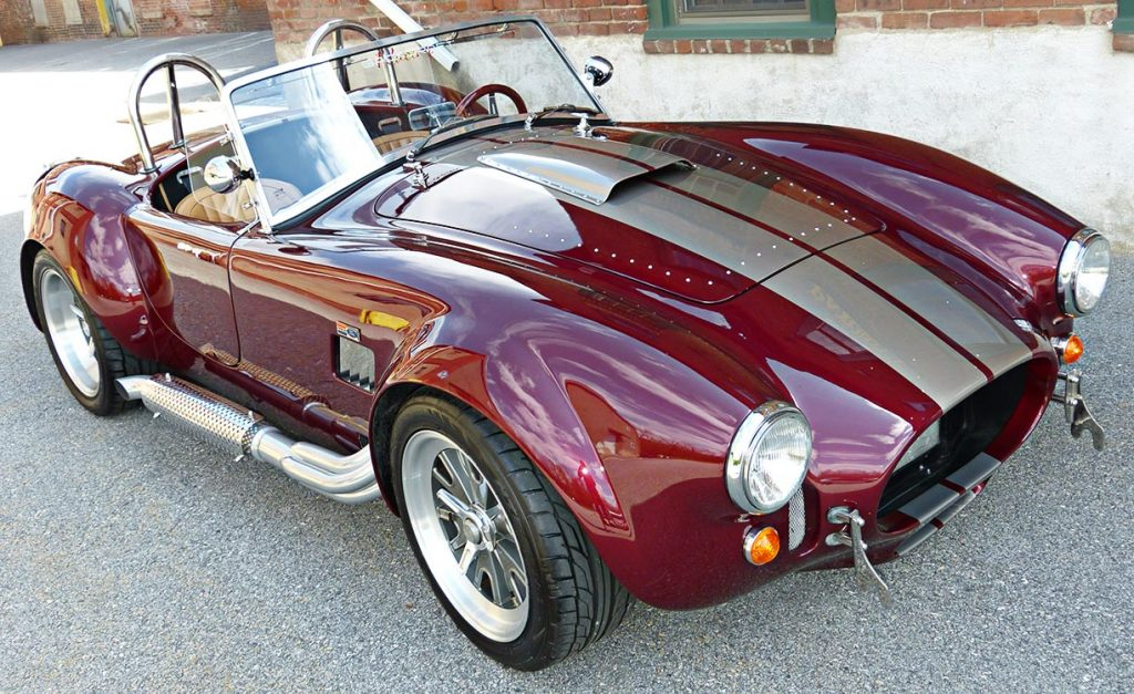 3/4-frontal shot of Prism Red Backdraft Racing 427SC Shelby classic Cobra for sale, BDR625