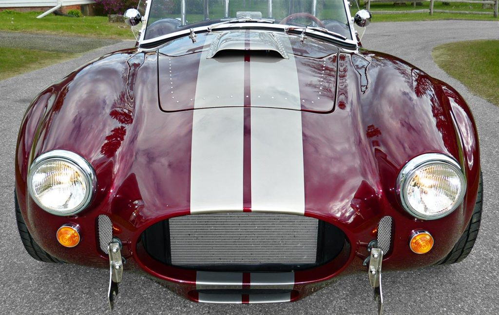 head-on frontal shot#1 of Prism Red Backdraft Racing 427SC Shelby classic Cobra for sale, BDR625