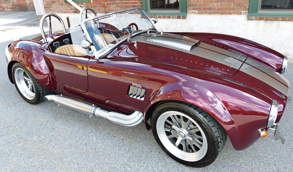 broadside shot of Prism Red Backdraft Racing 427SC Shelby classic Cobra for sale, BDR625