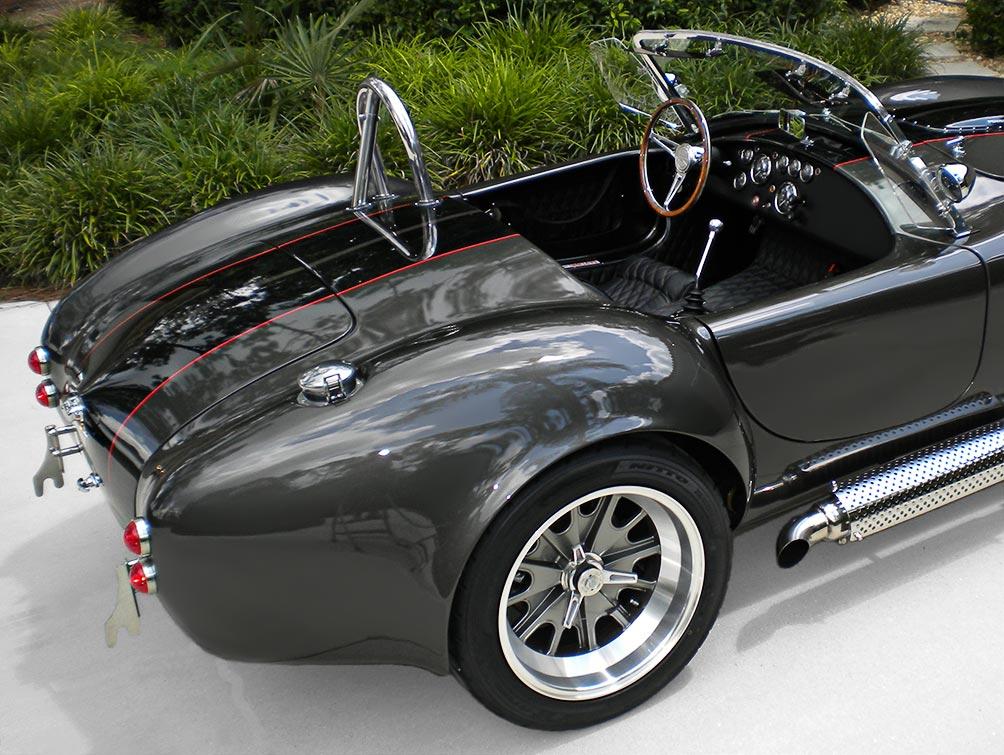 rear-quarter (passenger side) shot of Royal Grey Backdraft Racing 427SC Shelby classic Cobra for sale, BDR1357
