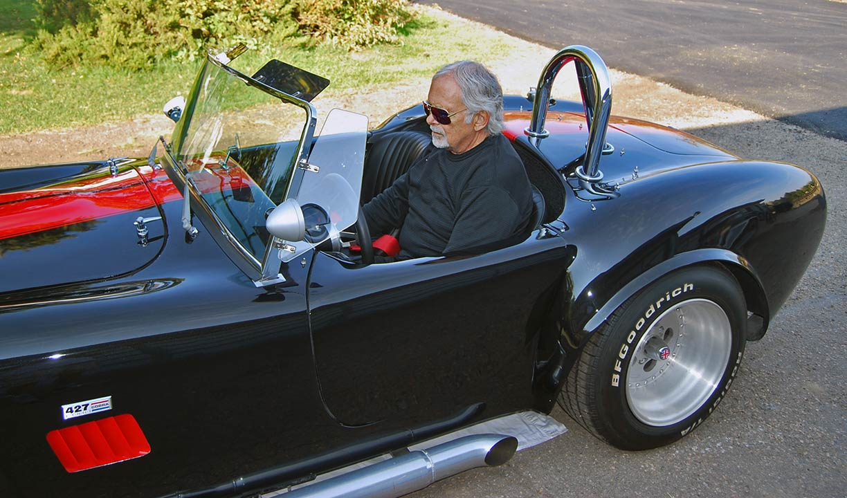My Dad behind the wheel during our photo-shoot of this black/red stripes 427SC Shell Valley classic Cobra for sale by owner