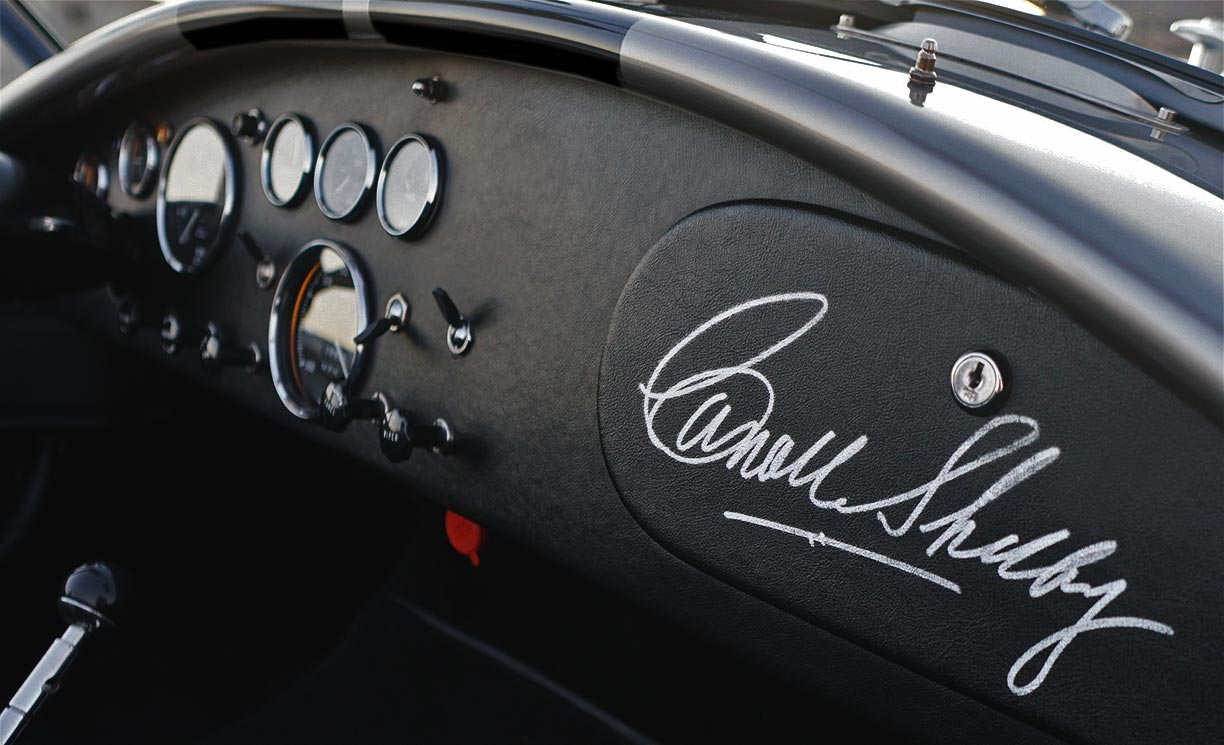photo#2 of Carroll Shelby's personal autograph on the glovebox door of silver/black stripes Superformance 427SC Shelby classic Cobra for sale, SPO2929