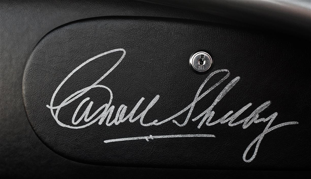 photo#1 of Carroll Shelby's personal autograph on the glovebox door of silver/black stripes Superformance 427SC Shelby classic Cobra for sale, SPO2929