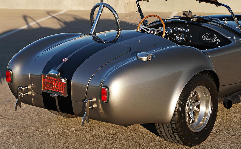 "passenger-side rear-quarter ""Golden Hour"" shot of silver/black stripes Superformance 427SC Shelby classic Cobra for sale, SPO2929"