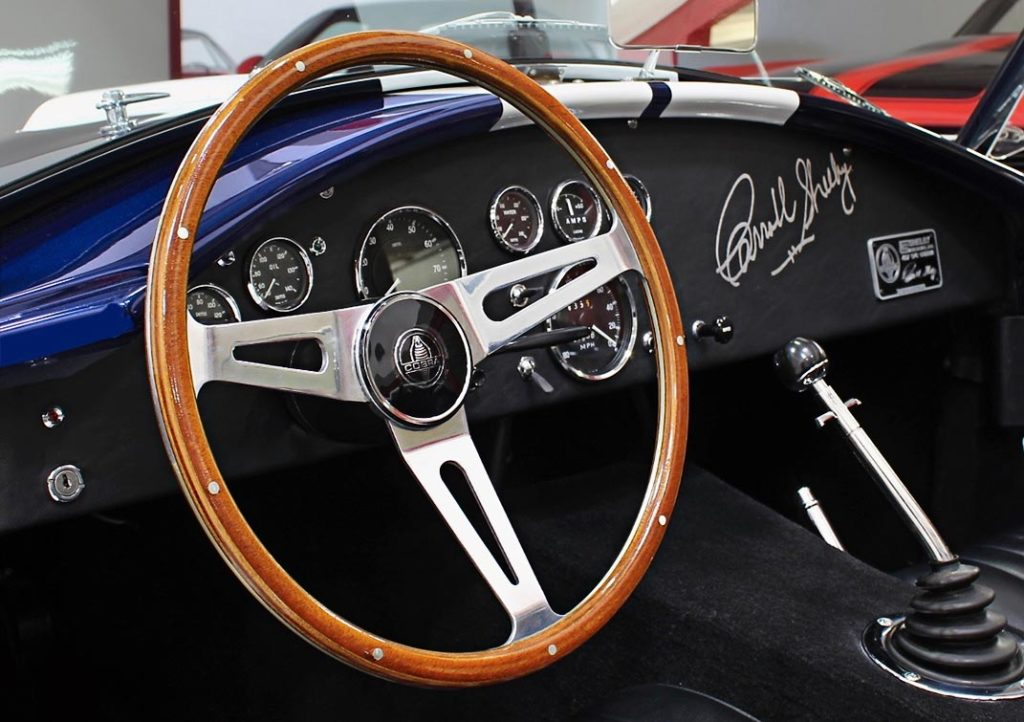 photo of hardwood-rim steering wheel and instrument panel (from driver side) of 35th Anniversary Blue Shelby 427SC Cobra for sale, CSX4059