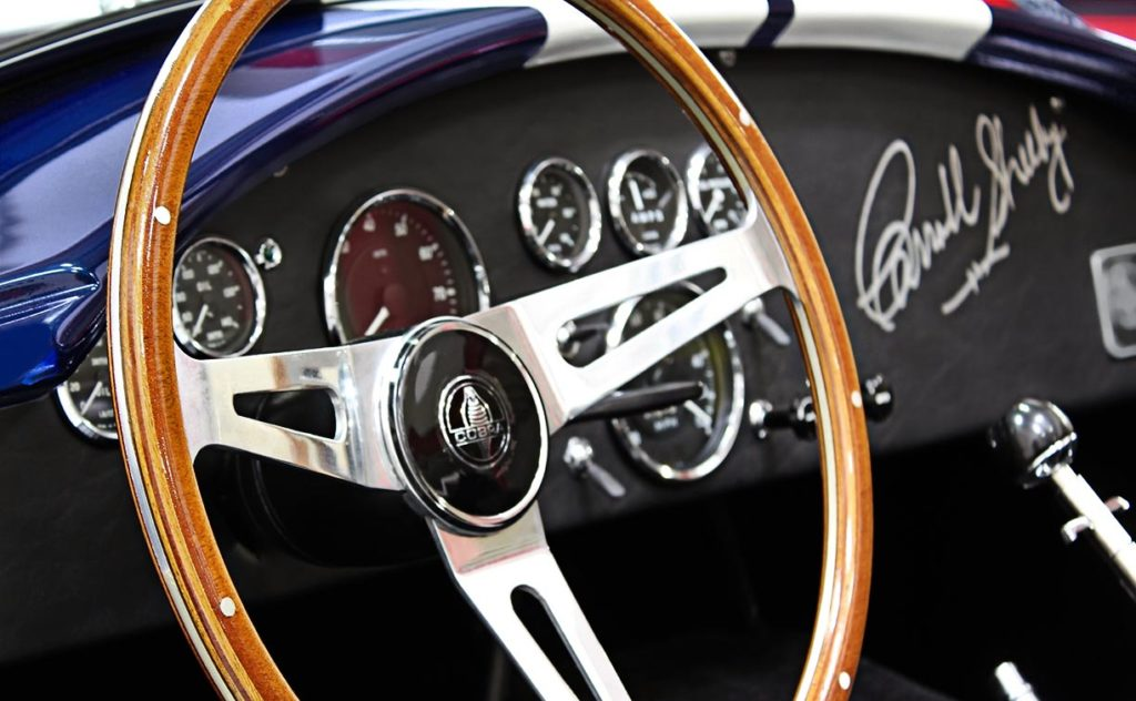 closeup shot of hardwood-rim steering wheel and instrument panel (from driver side) of 35th Anniversary Blue Shelby 427SC Cobra for sale, CSX4059
