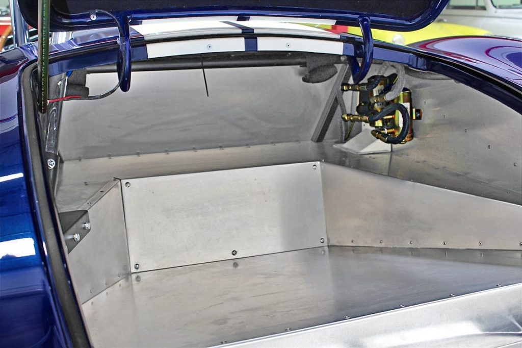 closeup shot of luggage compartment of 35th Anniversary Blue Shelby 427SC Cobra for sale, CSX4059