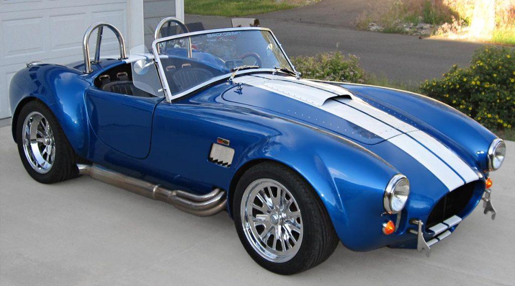3/4-frontal shot (passenger side) of Speedway Blue Backdraft Racing 427SC Shelby classic Cobra for sale, BDR757