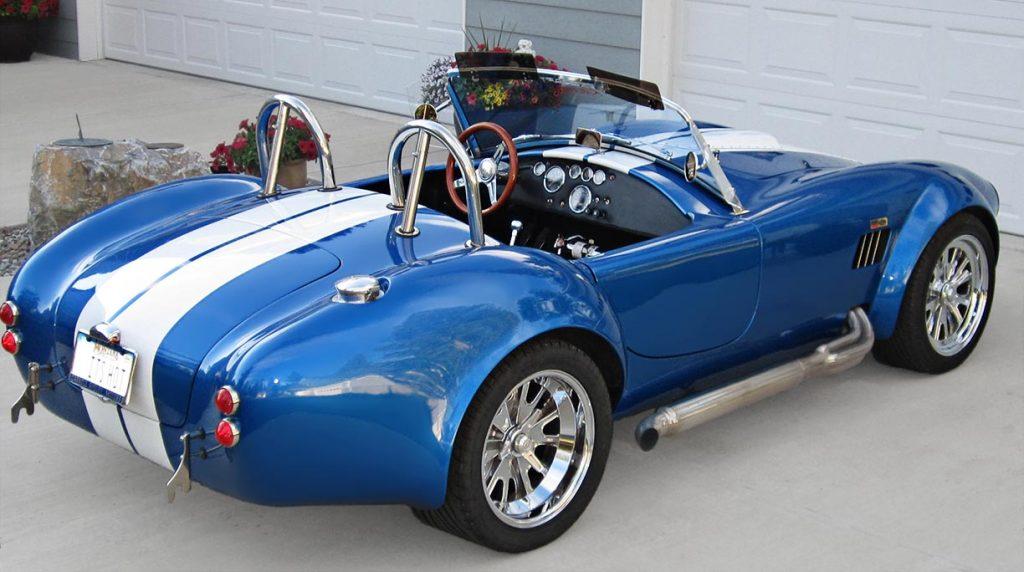 3/4-rear shot (passenger side) of Speedway Blue Backdraft Racing 427SC Shelby classic Cobra for sale, BDR757