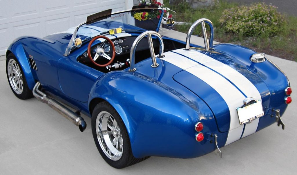 3/4-rear shot (driver side) of Speedway Blue Backdraft Racing 427SC Shelby classic Cobra for sale, BDR757