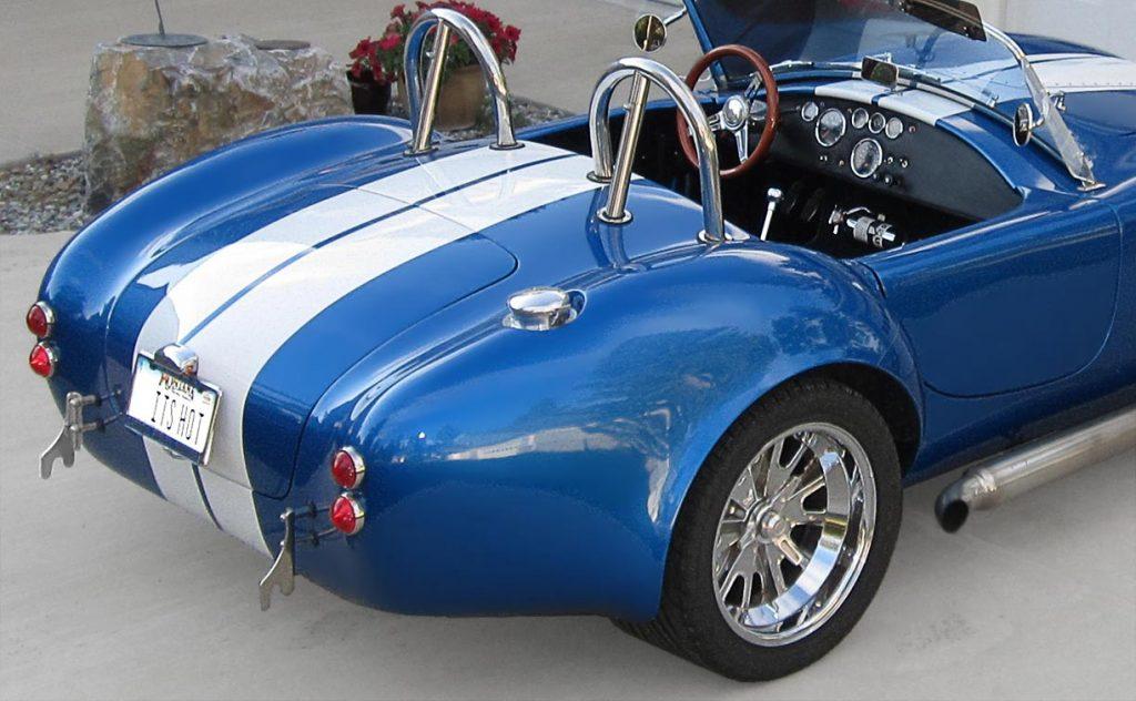 rear-quarter shot (passenger side) of Speedway Blue Backdraft Racing 427SC Shelby classic Cobra for sale, BDR757