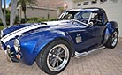 3/4-frontal thumbnail image of 'Arrival Blue' Factory Five Racing Mk 3.1 427SC Shelby classic Cobra (with hard top installed) for sale by owner