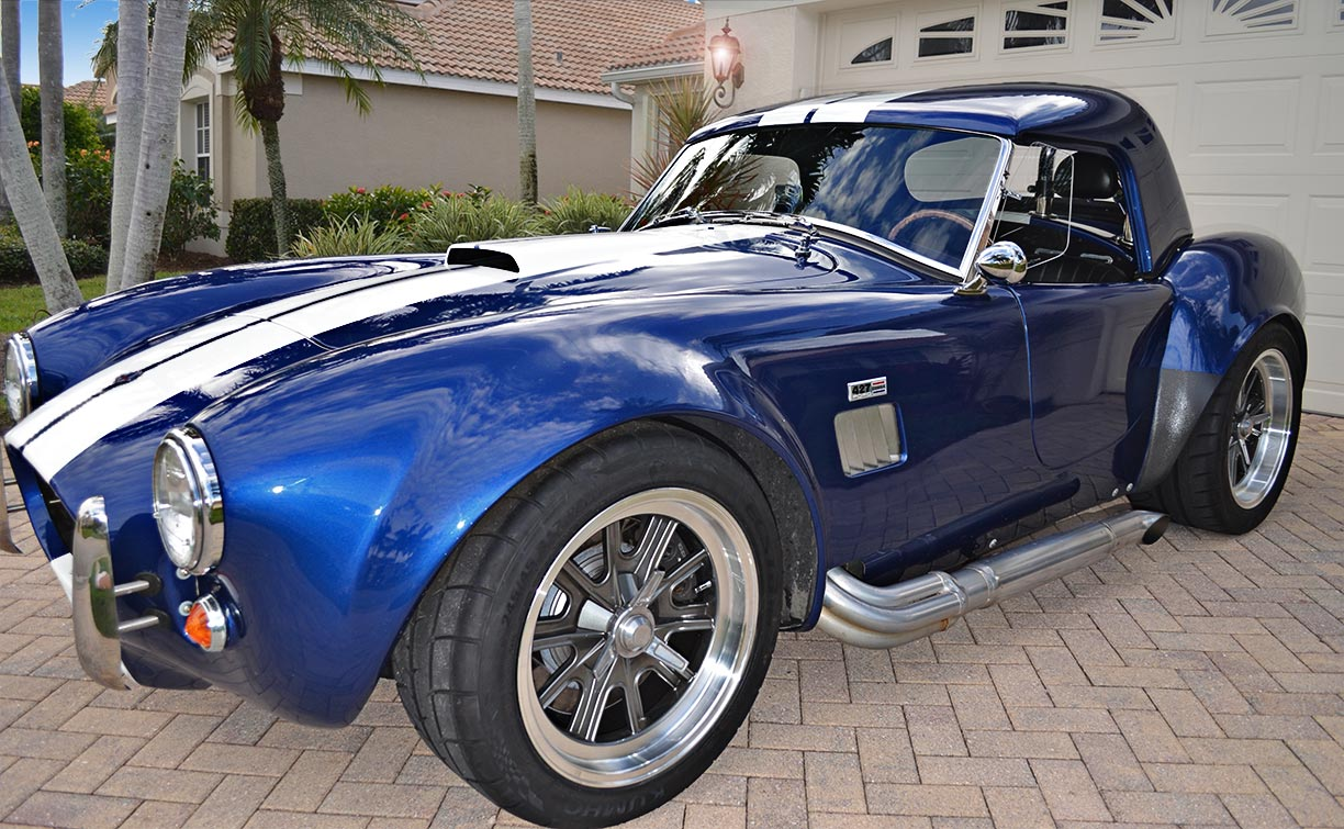 3/4-frontal image (driver side) of 'Arrival Blue' Factory Five Racing Mk 3.1 427SC Shelby classic Cobra (with hard top installed) for sale by owner