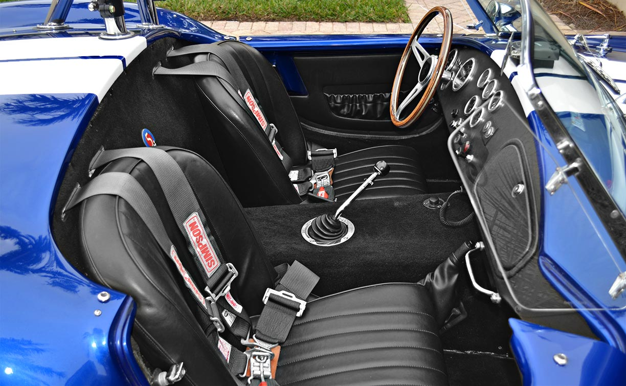 cockpit shot (from passenger side) of this 'Arrival Blue' Factory Five Racing Mk 3.1 427SC Shelby classic Cobra (with hard top installed) for sale by owner