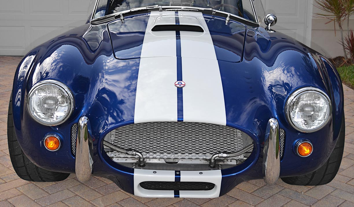 head-on frontal shot of this 'Arrival Blue' Factory Five Racing Mk 3.1 427SC Shelby classic Cobra for sale by owner