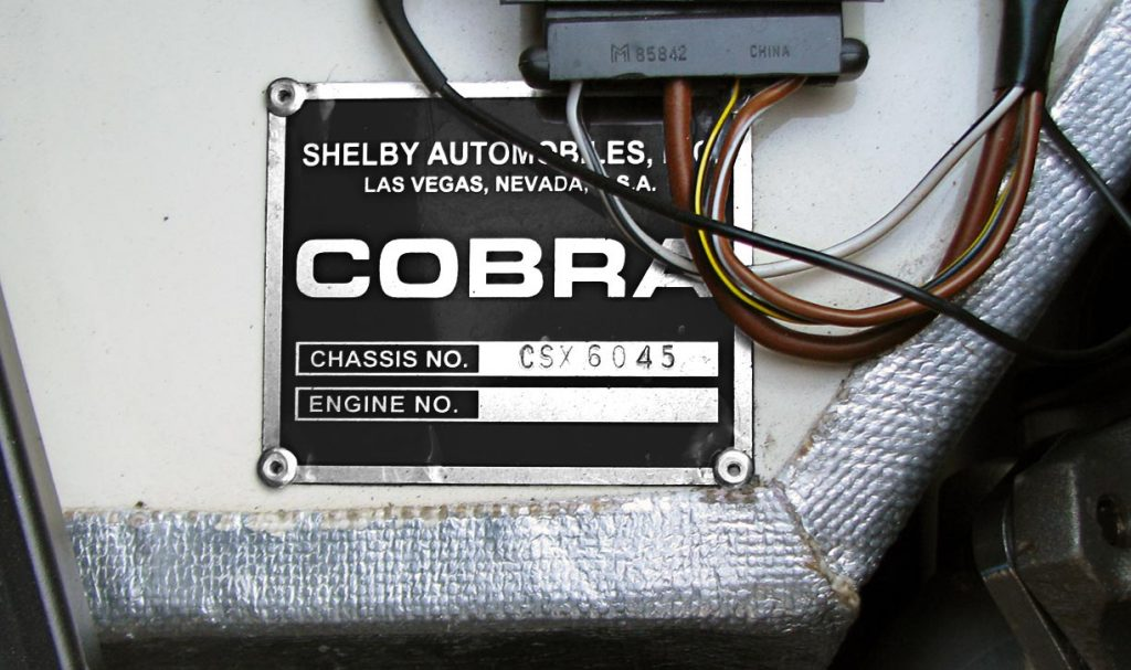 closeup shot of aluminum chassis plaque [CSX6045] for dashboard of Shelby 427SC Cobra for sale by owner