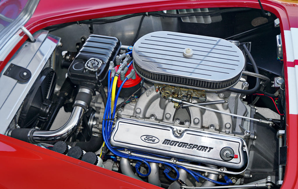 engine shot (from driver side) of Ford Victory Red classic Shelby 427SC Cobra by Hi-Tech Motorsports for sale