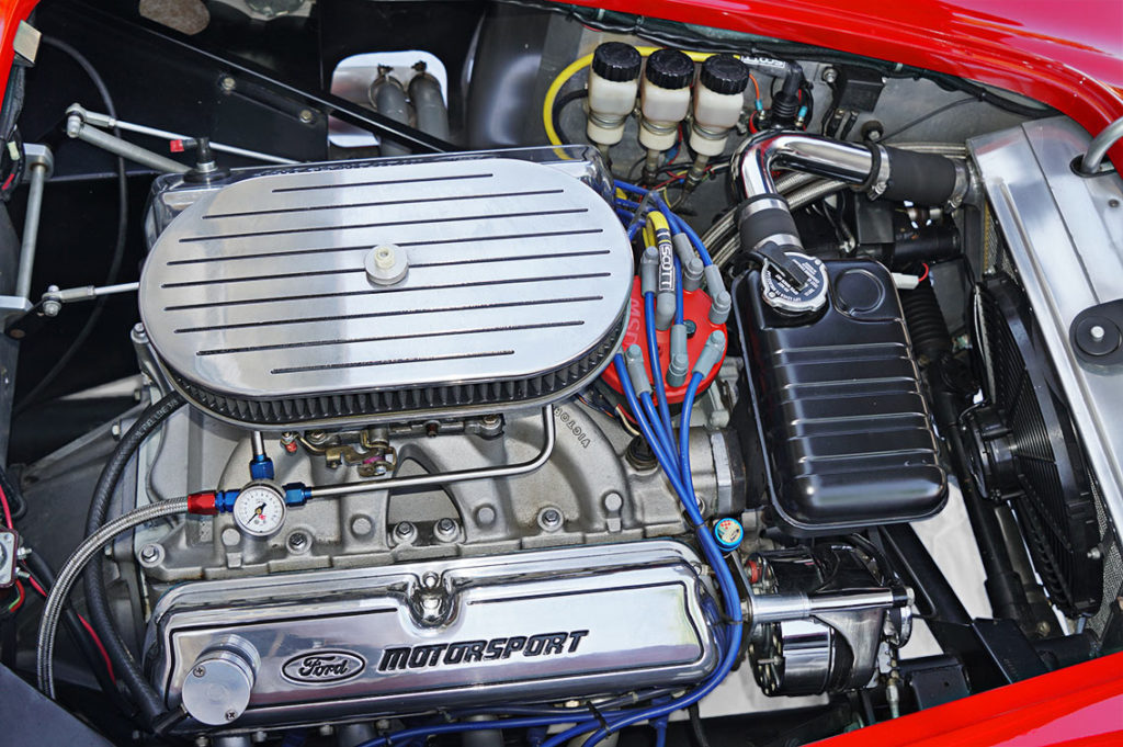 engine shot (from passenger side) of Ford Victory Red classic Shelby 427SC Cobra by Hi-Tech Motorsports for sale