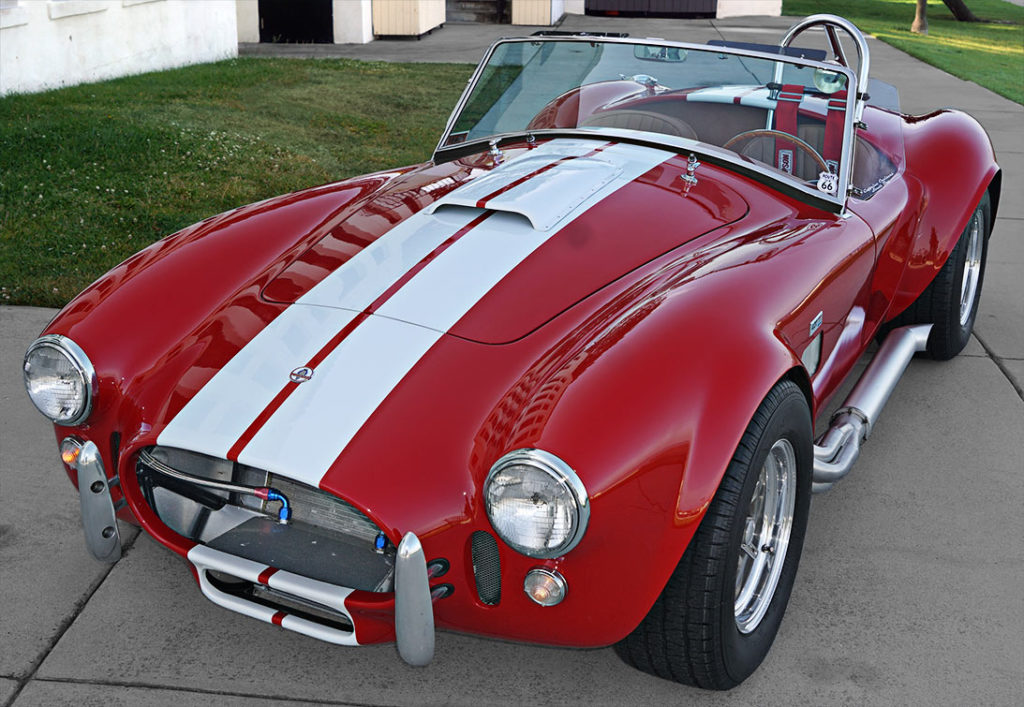 3/4-frontal view (driver side, alternate angle) of Ford Victory Red classic Shelby 427SC Cobra by Hi-Tech Motorsports for sale