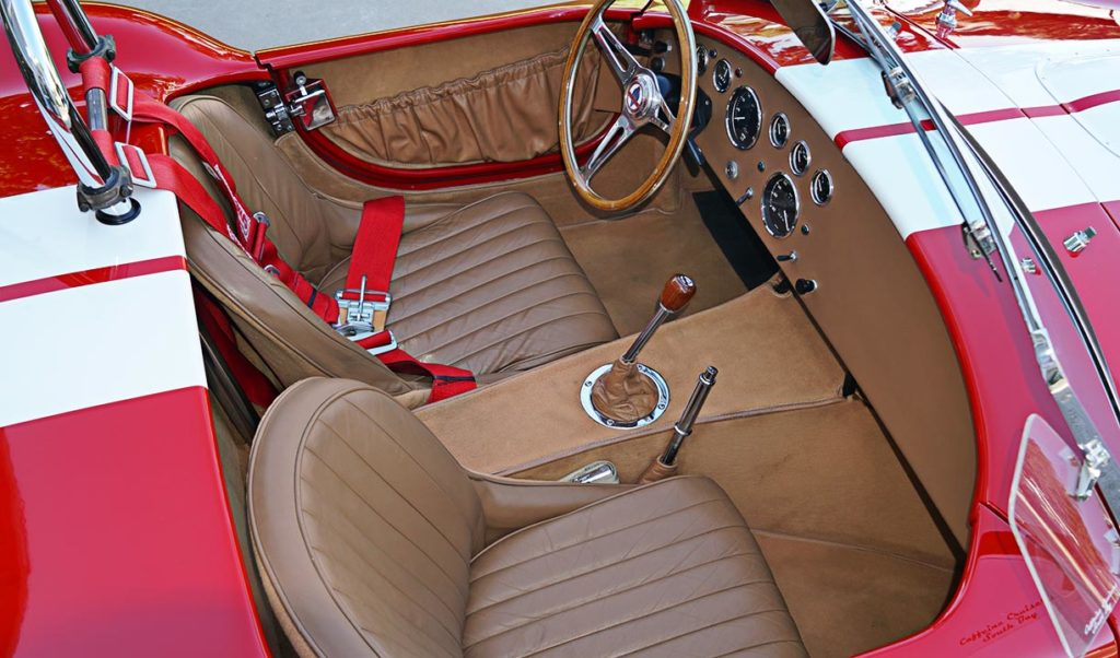 cockpit shot (from passenger side) of Ford Victory Red classic Shelby 427SC Cobra by Hi-Tech Motorsports for sale