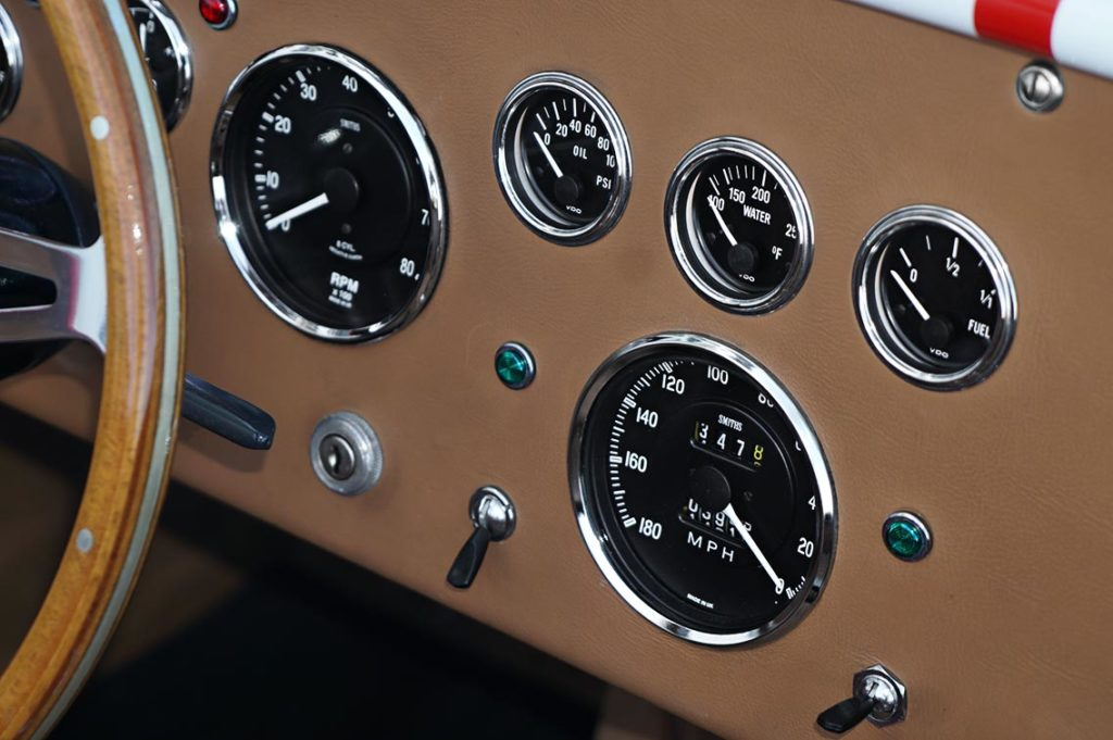 instrument gauges closeup shot of Ford Victory Red classic Shelby 427SC Cobra by Hi-Tech Motorsports for sale