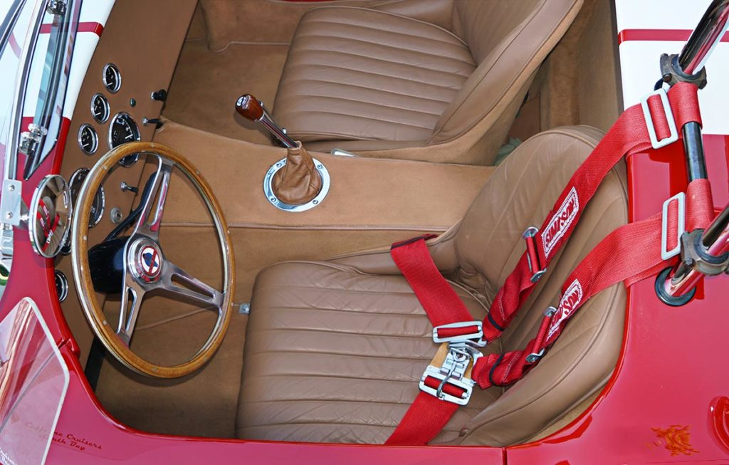 cockpit shot (from drivers side) of Ford Victory Red classic Shelby 427SC Cobra by Hi-Tech Motorsports for sale