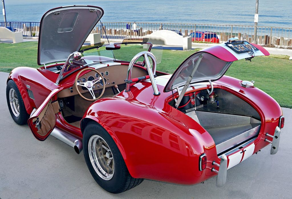 all decks open shot (driver side) of Ford Victory Red classic Shelby 427SC Cobra by Hi-Tech Motorsports for sale