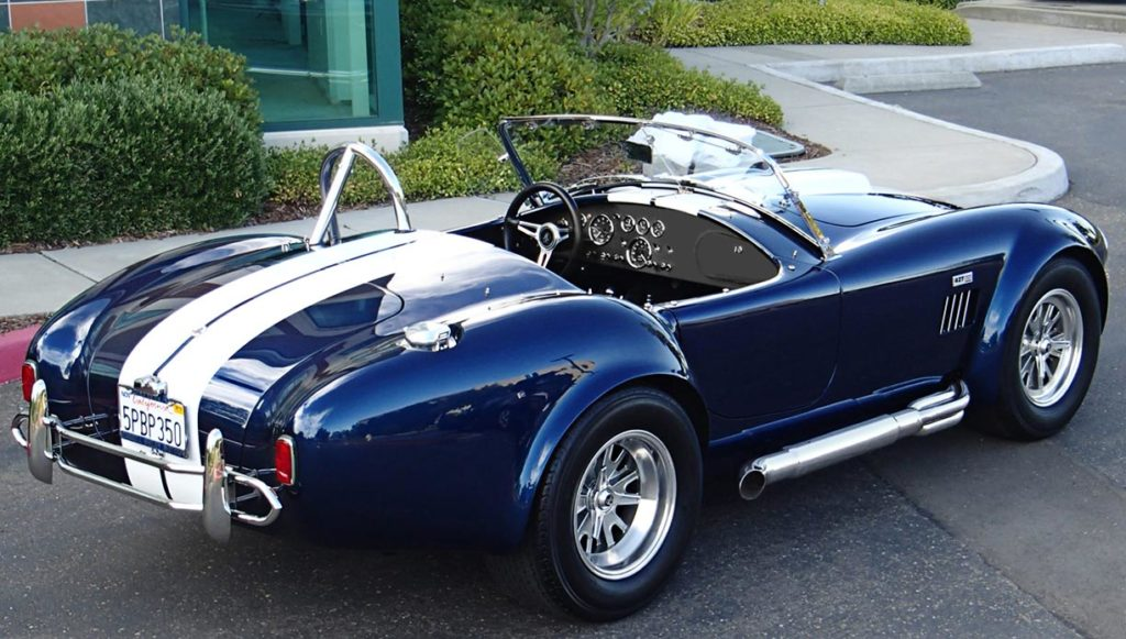 3/4-rear shot (passenger side) of Indigo Blue/Arctic White stripes Superformance 427SC Shelby classic Cobra for sale by owner, SPO1983