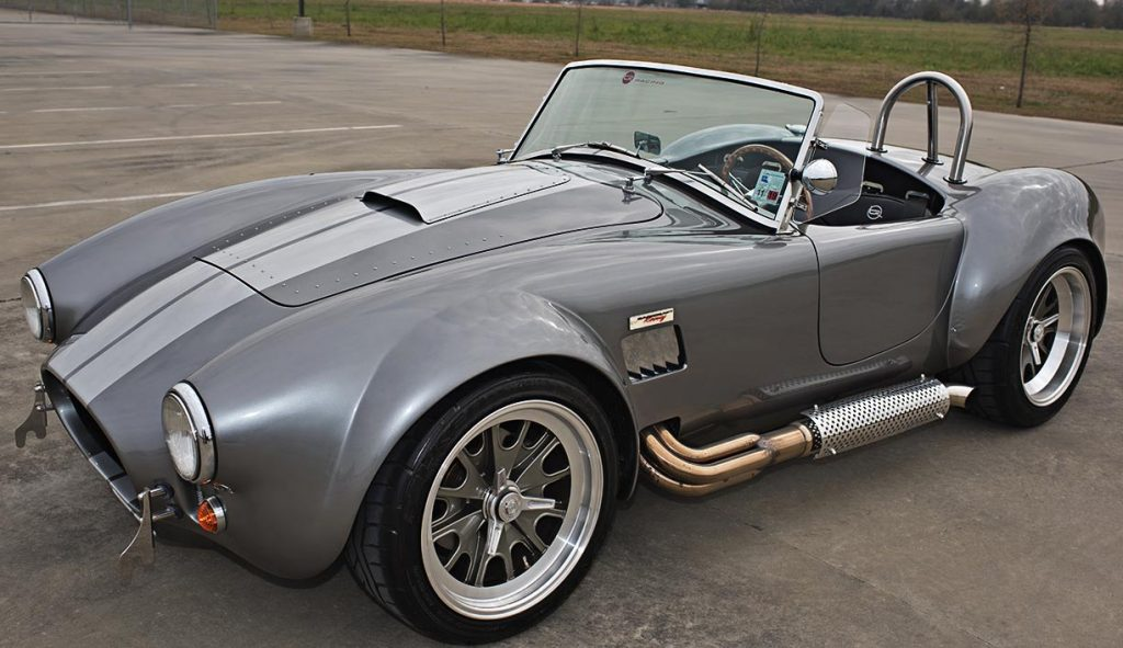 3/4-frontal photo of Sterling Grey/silver stripes Backdraft Racing 427SC Shelby Cobra for sale