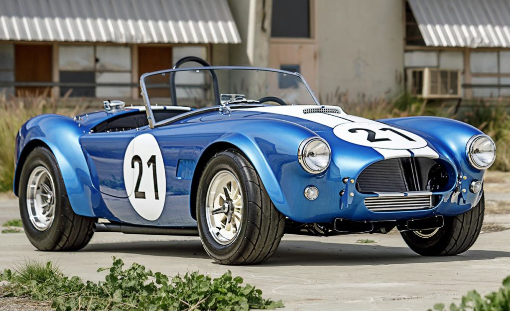 3/4-frontal view (passenger side) of Guardsman Blue classic Shelby 289FIA Bondurant Edition Cobra vehicle for sale, CSX2771