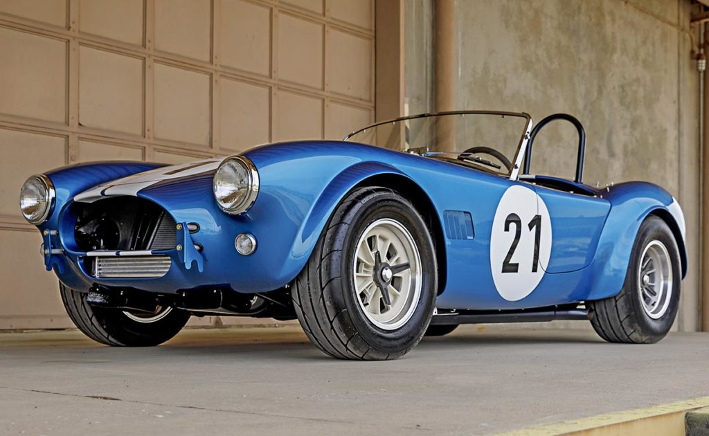 3/4-frontal view (driver side, low camera angle) of Guardsman Blue classic Shelby 289FIA Bondurant Edition Cobra vehicle for sale, CSX2771