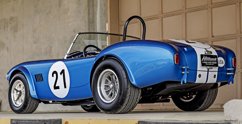 3/4-rear view (driver side, low camera angle) of Guardsman Blue classic Shelby 289FIA Bondurant Edition Cobra vehicle for sale, CSX2771