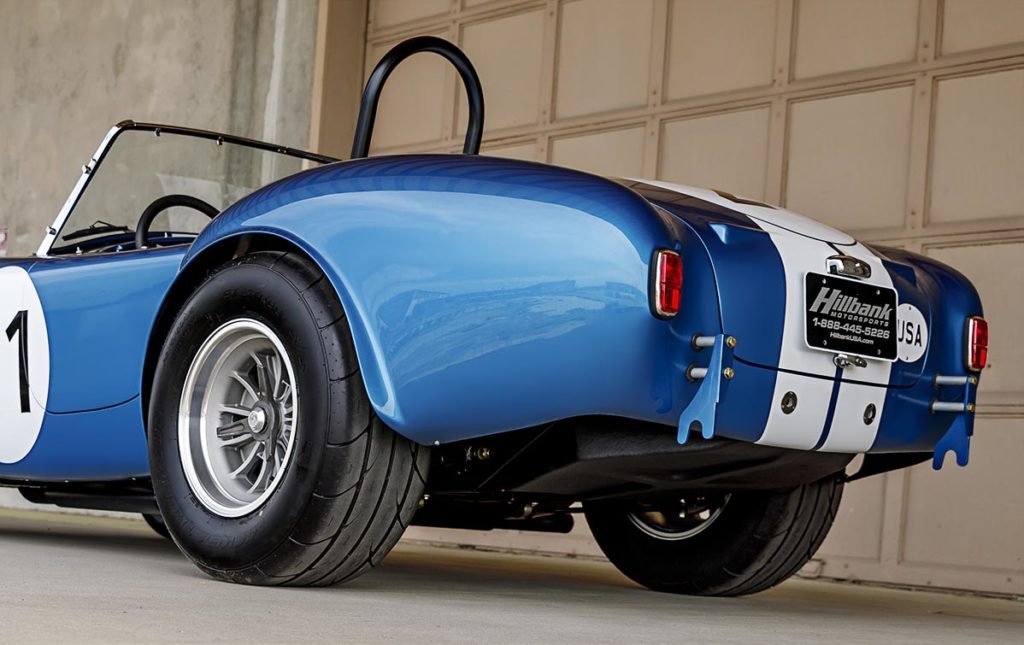 Rear Quarter view (driver side, low camera angle) of Guardsman Blue classic Shelby 289FIA Bondurant Edition Cobra vehicle for sale, CSX2771