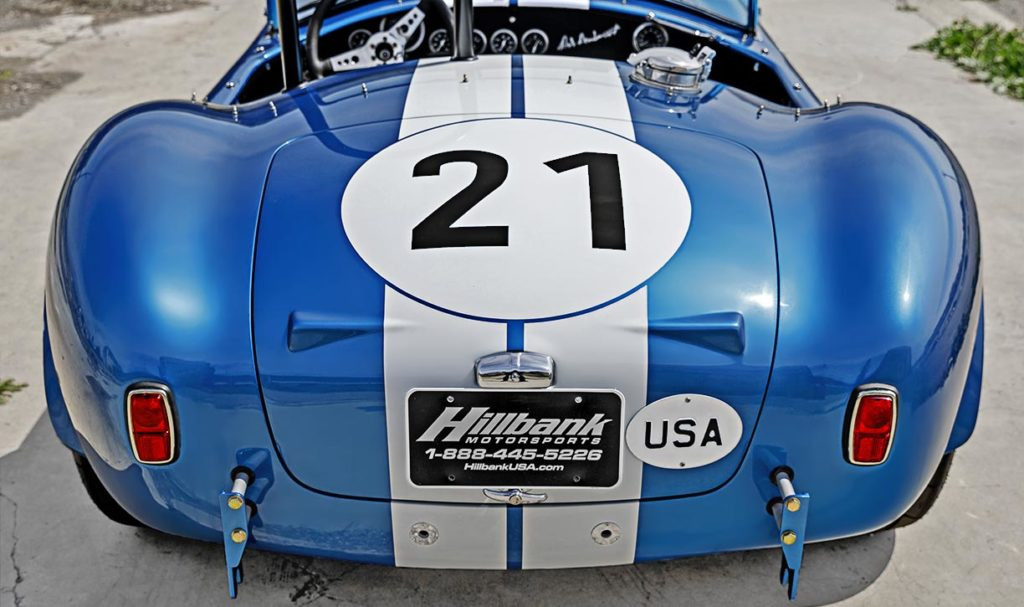 head-on rear view (driver side, high camera angle) of Guardsman Blue classic Shelby 289FIA Bondurant Edition Cobra vehicle for sale, CSX2771