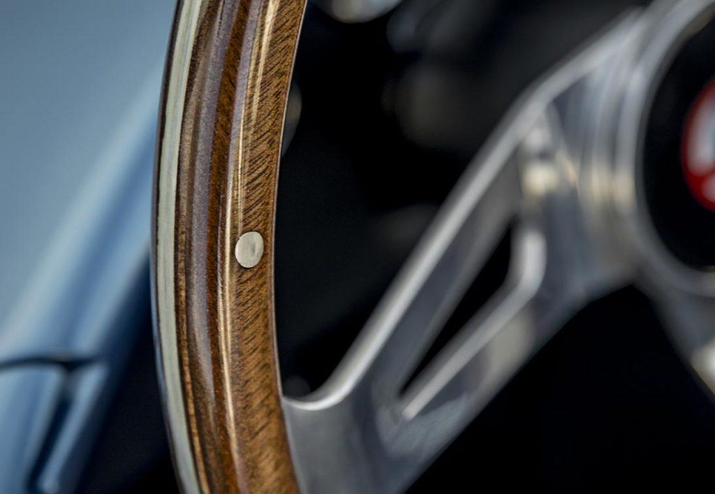 closeup photo the mahogany hardwood rim on this Guardsman Blue Shelby 427SC Cobra, CSX6132