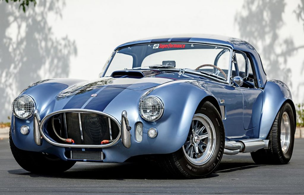 3/4-frontal view (driver side, with hard top installed) of Portofino Blue Superformance Shelby 427SC Cobra for sale, SPO0545