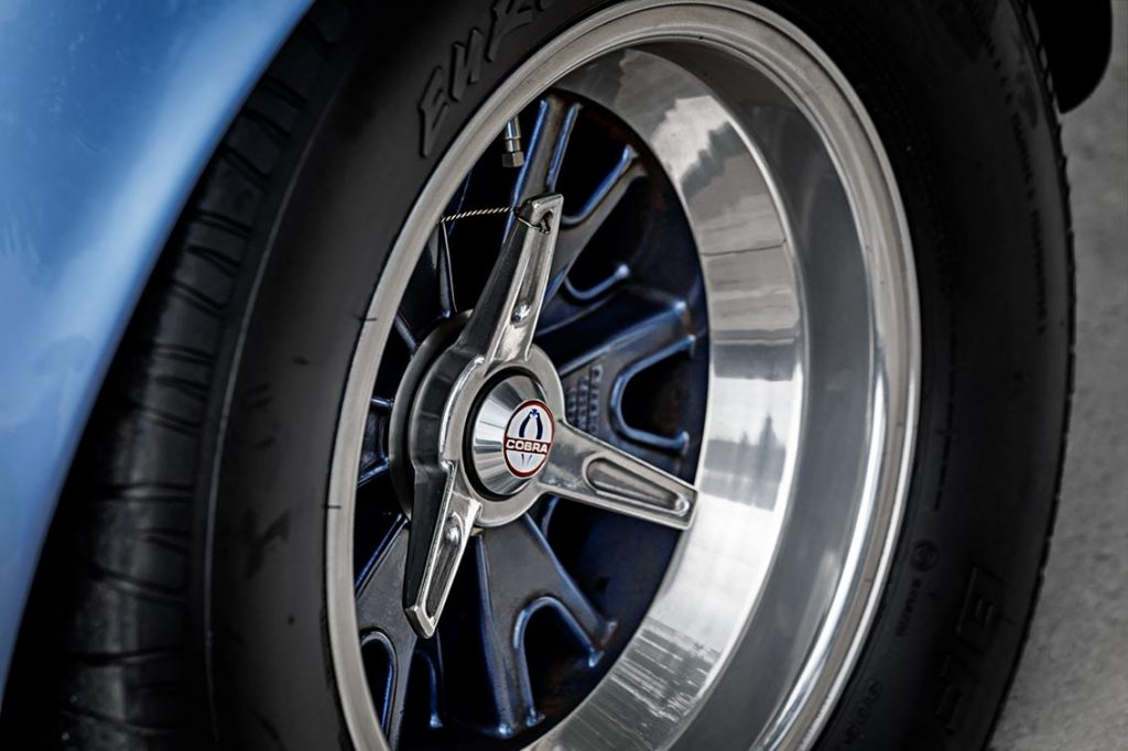 closeup shot of Halibrand reproduction wheel shod with BFG 'Radial T/A' rubber of blue Superformance Shelby 427SC Cobra for sale, SPO0545