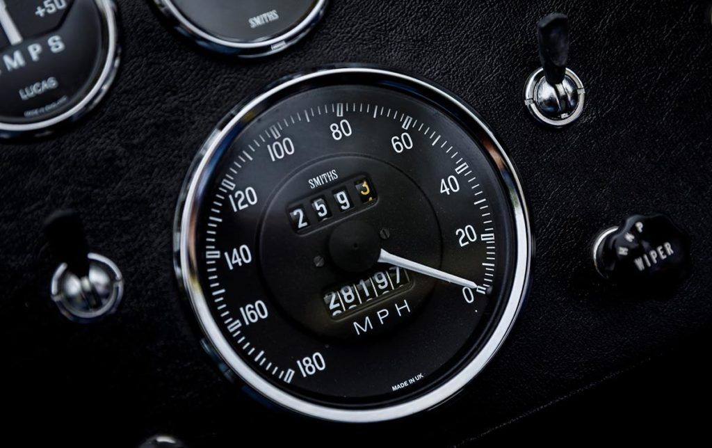 closeup shot of Smiths speedometer and Lucas switches on Jasmine Yellow Superformance 427SC Shelby Roadster (Street Version) Cobra vehicle for sale, SPO1076