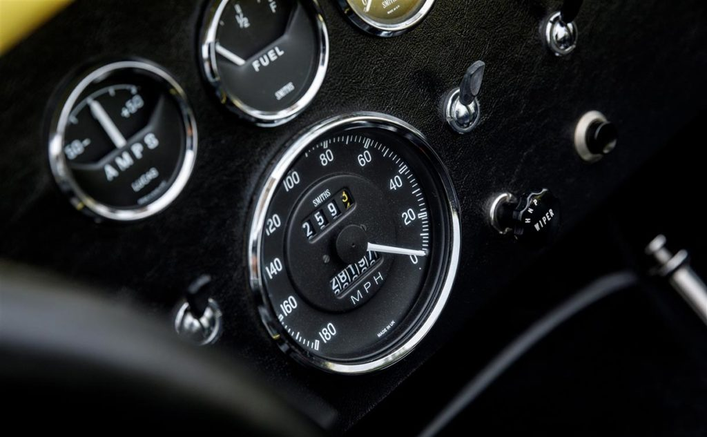 closeup shot of Smiths speedometer and Lucas gauges cluster on Jasmine Yellow Superformance 427SC Shelby Roadster (Street Version) Cobra vehicle for sale, SPO1076