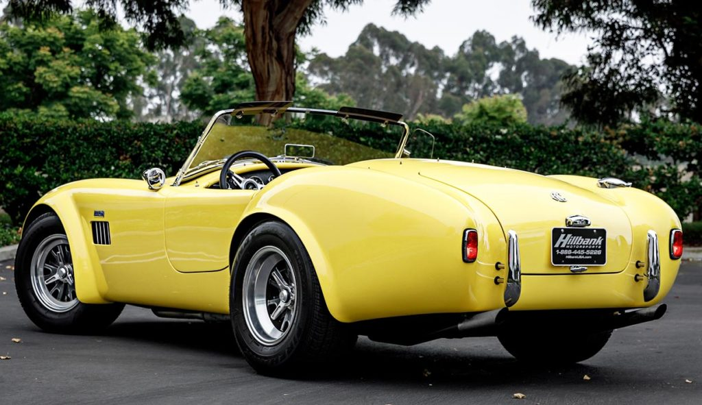 3/4-rear shot (driver side) of Jasmine Yellow Superformance 427SC Shelby Roadster (Street Version) Cobra vehicle for sale, SPO1076