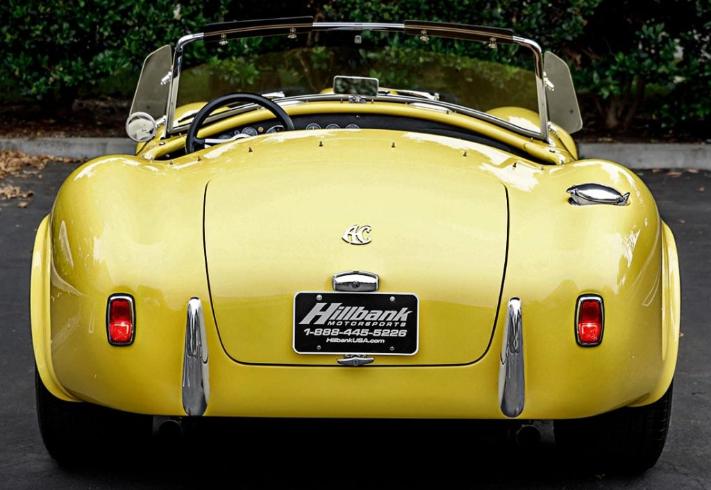 head-on rear shot of Jasmine Yellow Superformance 427SC Shelby Roadster (Street Version) Cobra vehicle for sale, SPO1076