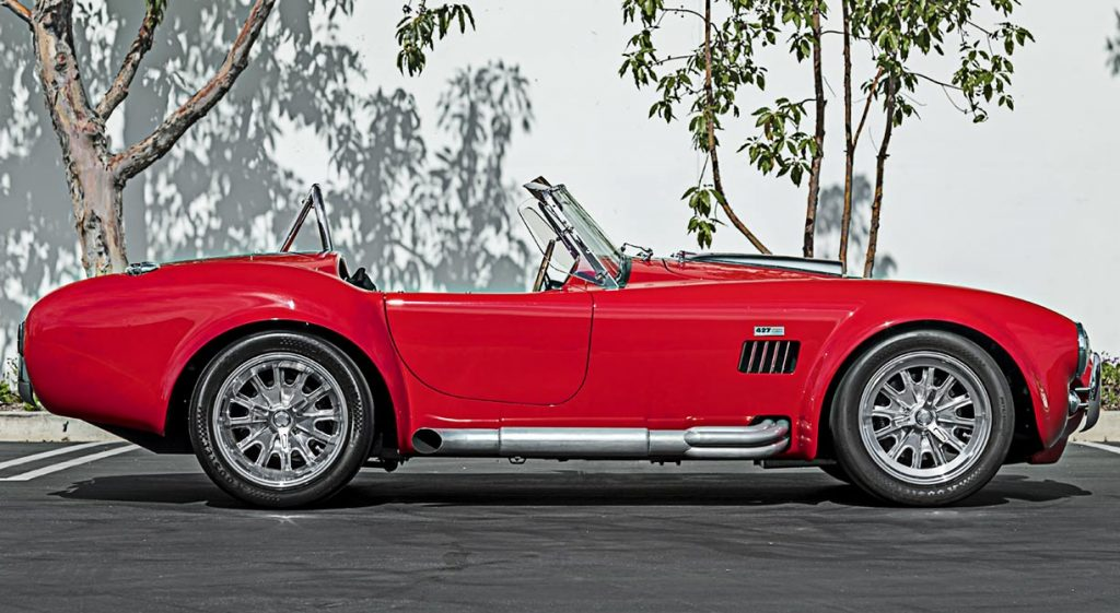 passenger side shot of red Superformance 427 Cobra for sale by Hillbank Motors on this page