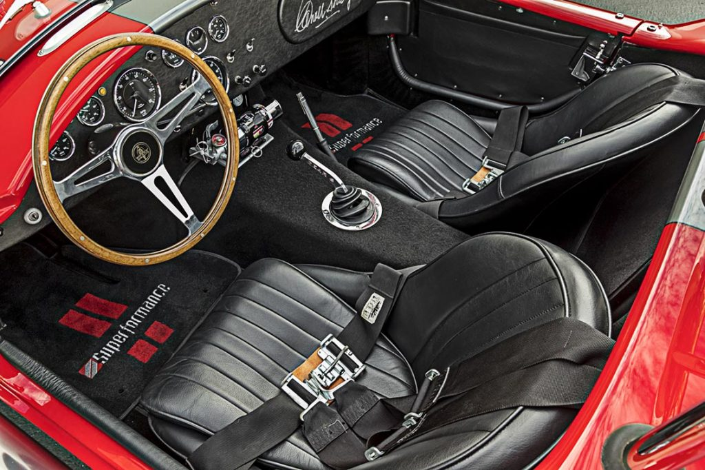 aerial cockpit shot of red Superformance 427 Cobra