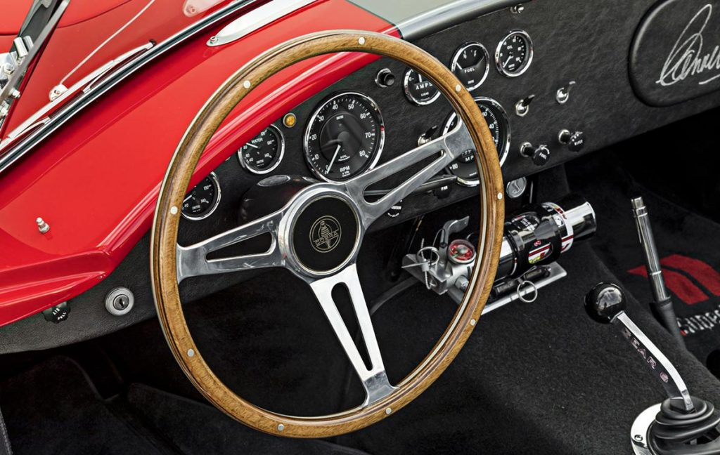shifter and instrument panel shot of red Superformance 427 Cobra