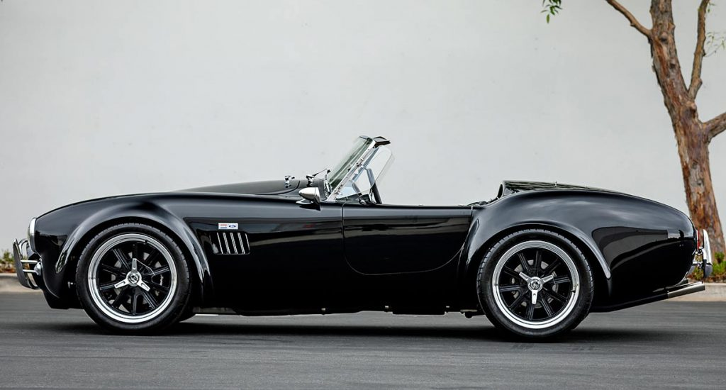 broadside/driver-side view of black Superformance 427SC Cobra for sale, SPO2980