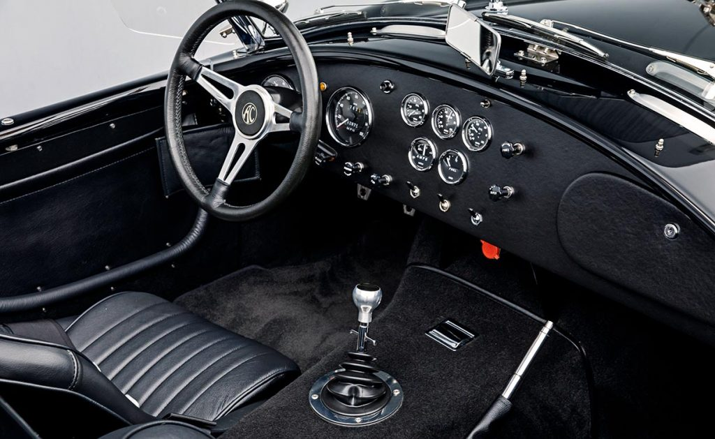 photo of cockpit, Moto-Lita leather-wrapped steering wheel and dashboard of black Superformance 427SC Cobra for sale, SPO2980