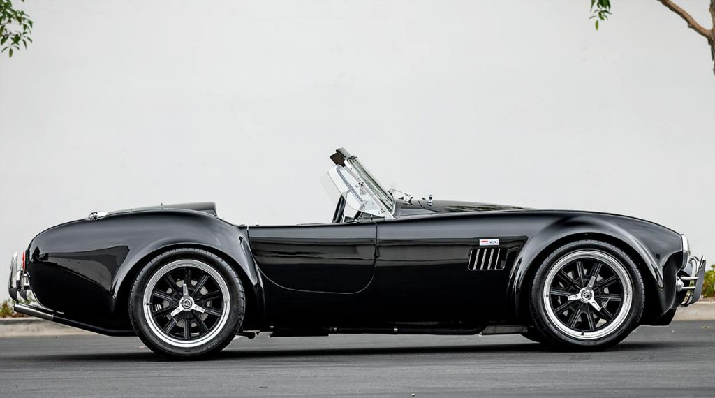 broadside/passenger-side view of black Superformance 427SC Cobra for sale, SPO2980